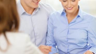 smiling couple at bank